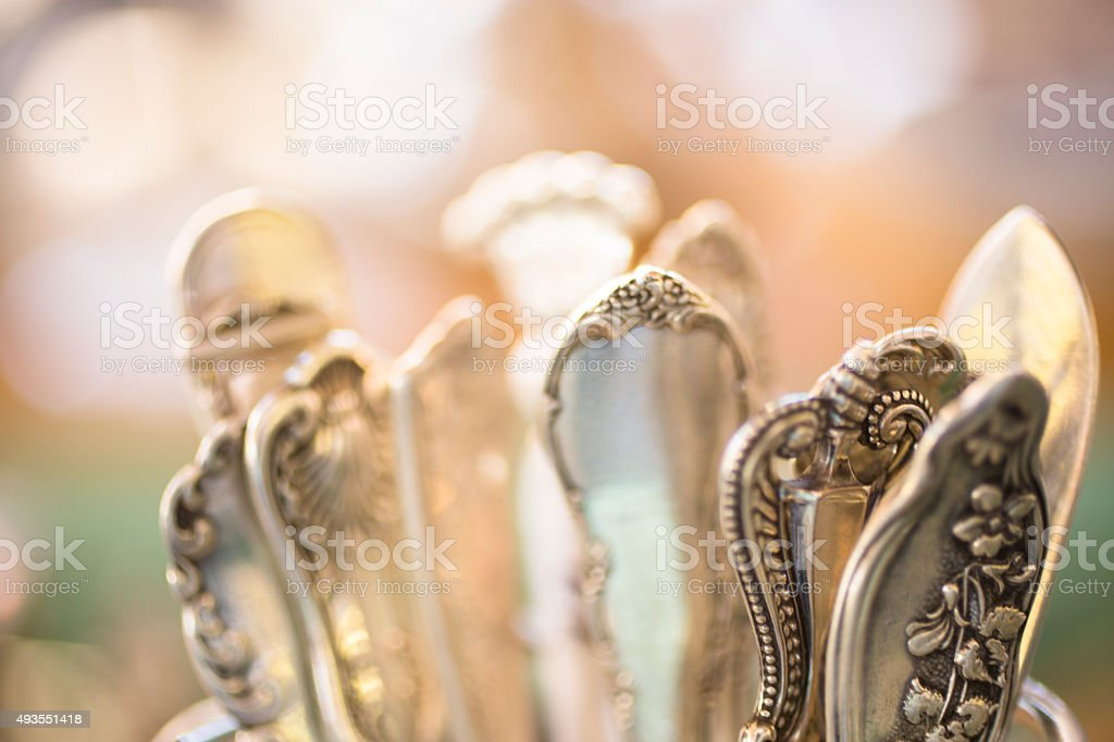 Variety of antique silverware patterns. Flatware handles. stock photo