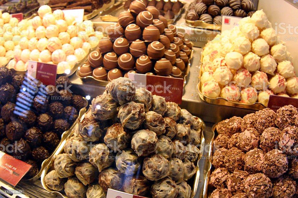 Variety of artisan chocolate truffles in display case stock photo