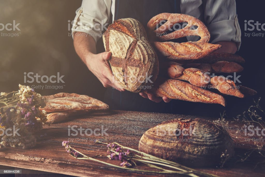 Variety of bread hold men's hands stock photo