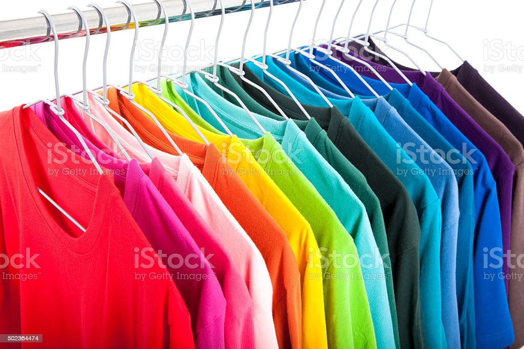 Variety of casual shirts on hangers stock photo