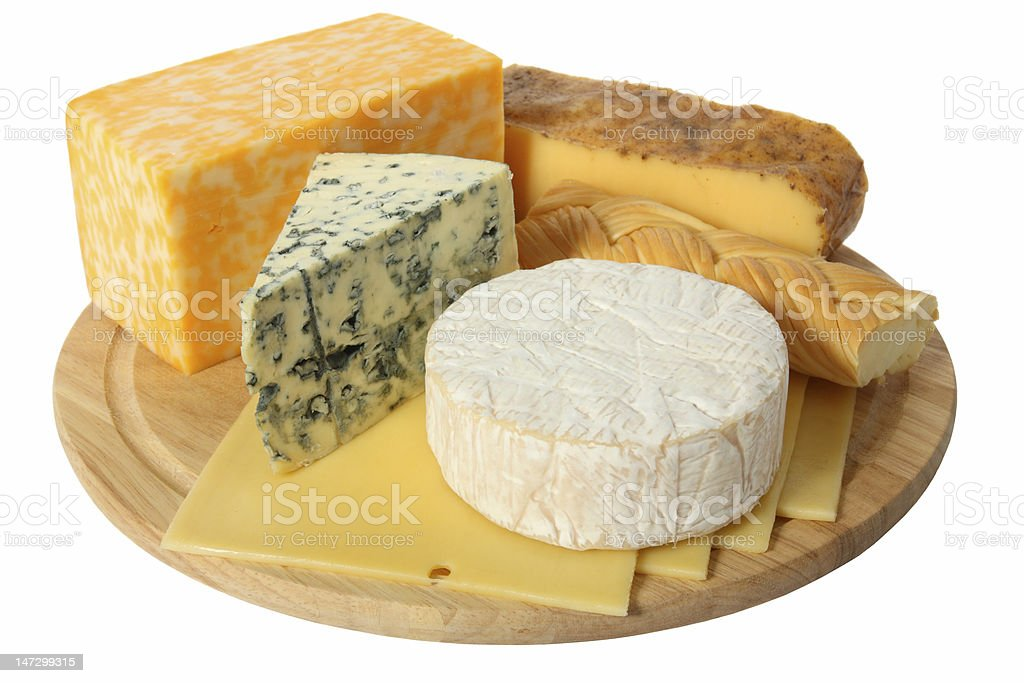 Variety of cheese being served on a wooden platter stock photo