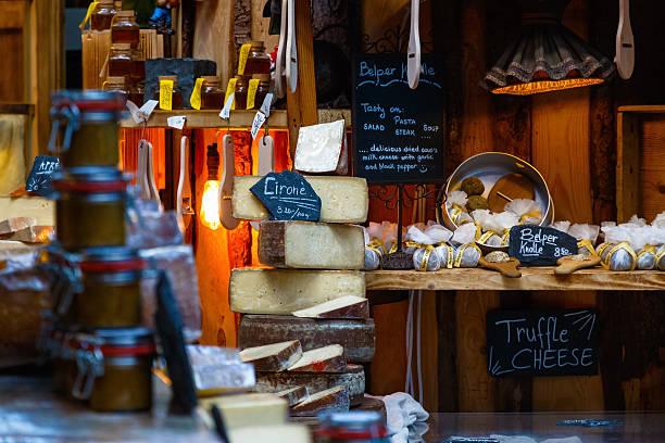 variety of cheeses on display - hofladen stock-fotos und bilder