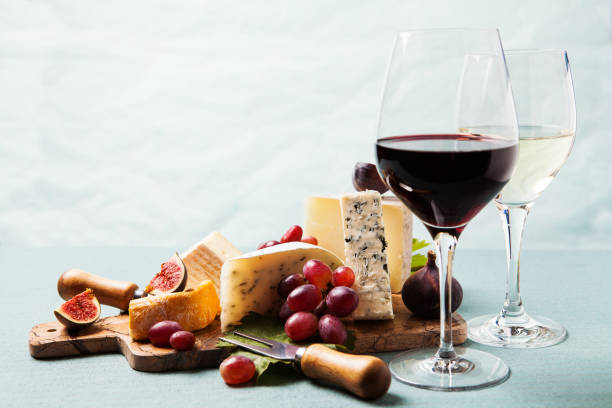 Variety of cheeses on serving board Cheese board: variety of cheeses on marble serving board wine and cheese stock pictures, royalty-free photos & images