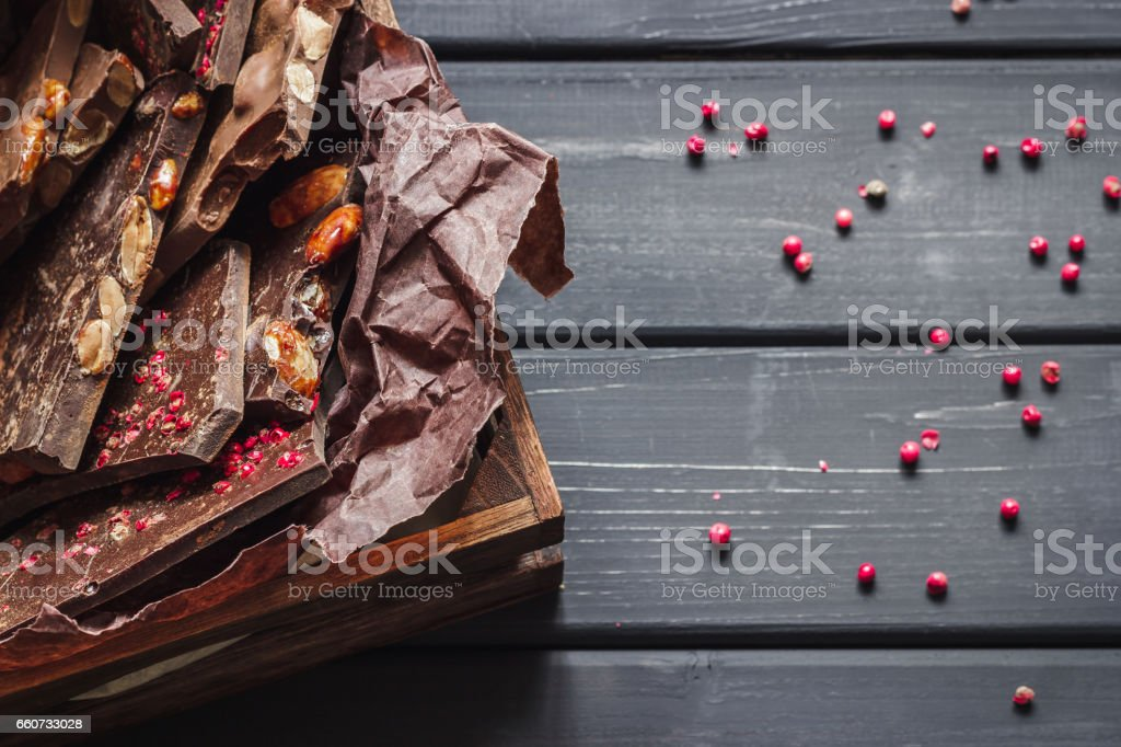 Variety of chocolate bars in wooden box - Photo