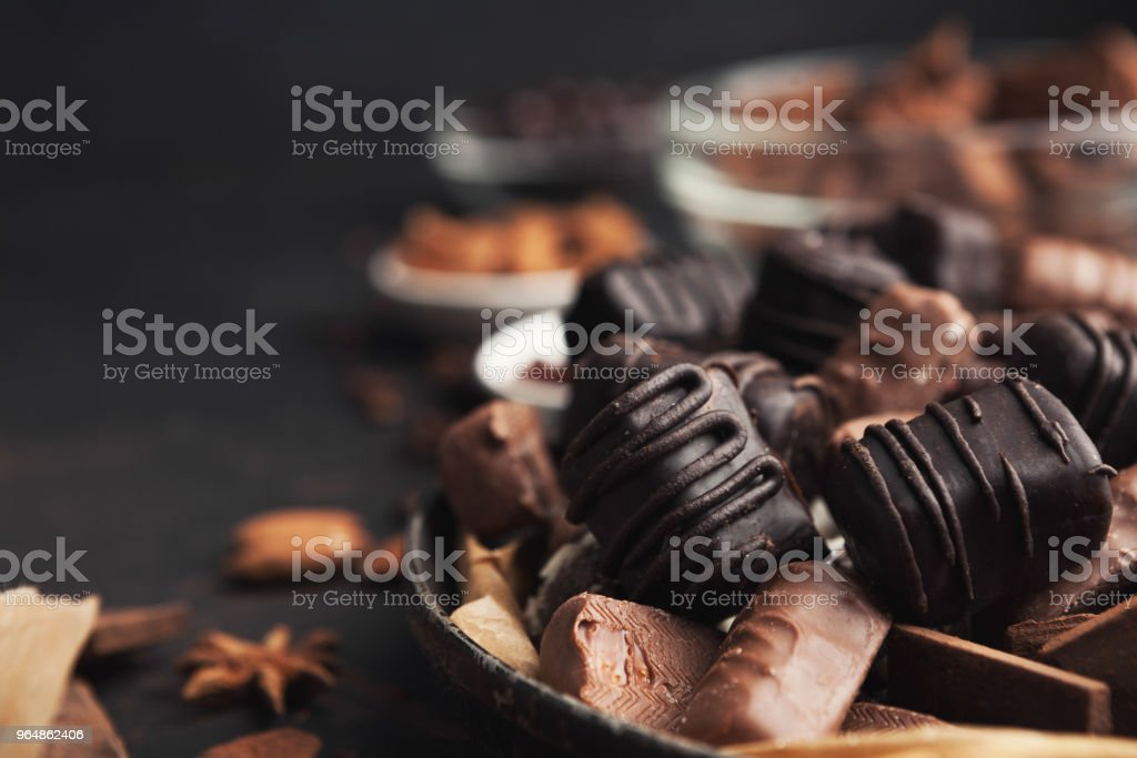 Variety of chocolate candies in old fashioned bowl royalty-free stock photo