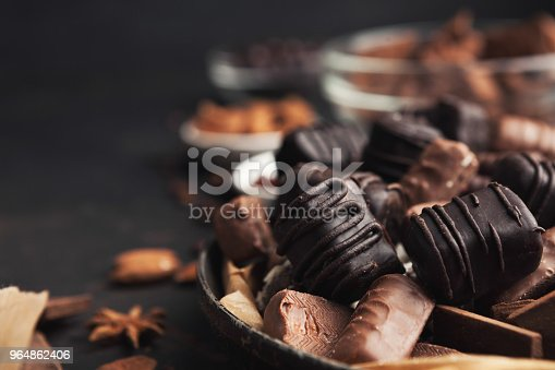 istock Variety of chocolate candies in old fashioned bowl 964862406