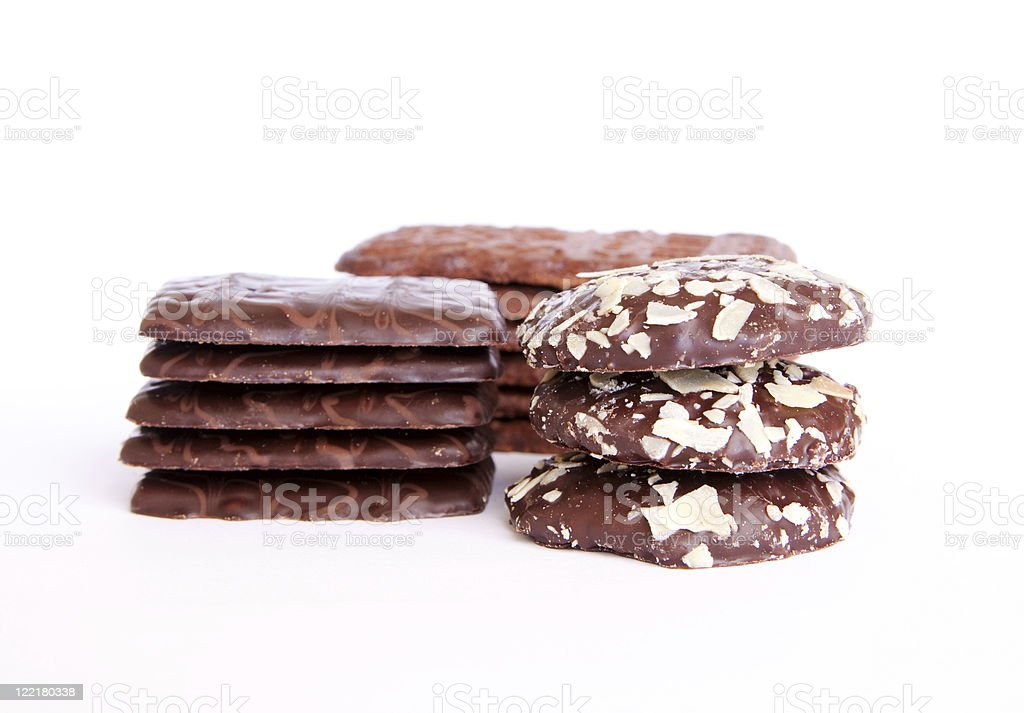 Variety of Chocolate Cookies Stacked Up on a White Background stock photo