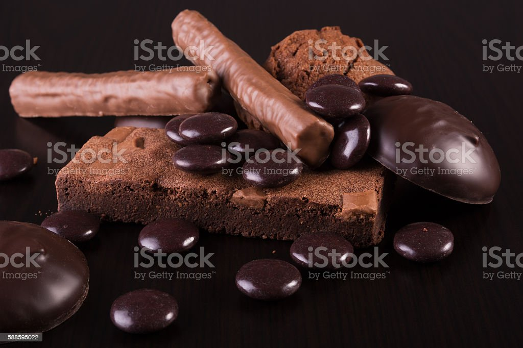 Variety of Chocolate sweets on dark wooden background stock photo