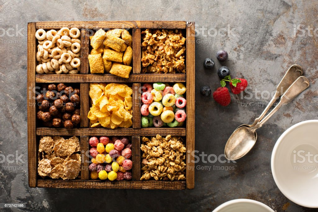 Variety of cold cereals in a wooden box overhead royalty-free stock photo
