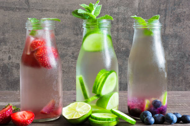 Variety of cold summer drinks in small bottles Variety of cold summer drinks in small bottles. detox water mint leaf culinary stock pictures, royalty-free photos & images
