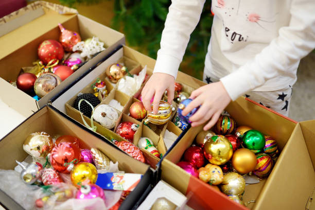 Variety of colorful Christmas baubles in a boxes. Trimming the Christmas tree. stock photo
