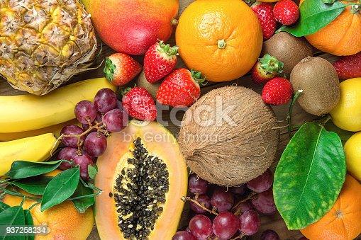 istock Variety of Colorful  of Fresh Tropical and Summer Seasonal Fruits Pineapple Papaya Mango Coconut Oranges Kiwi Bananas Lemons Grapefruit Strawberries. Healthy Plant Based Diet Superfoods Concept. 937258234