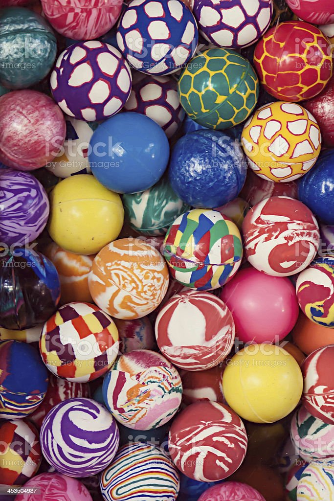 Variety of Colorful Rubber Bouncing Balls in Machine stock photo