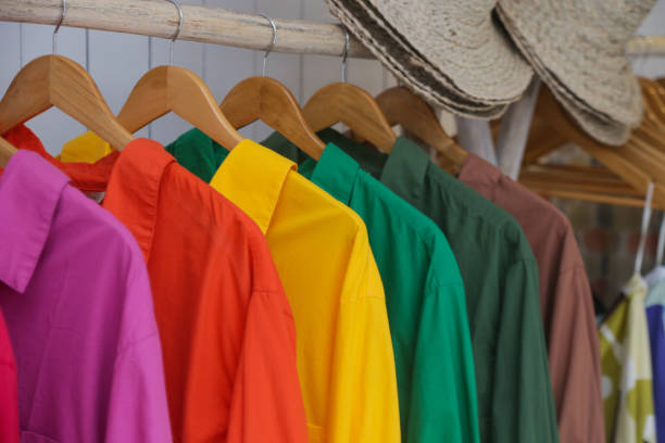 variety of colorful shirts hanging on the wooden hangers, close up - climate clock imagens e fotografias de stock