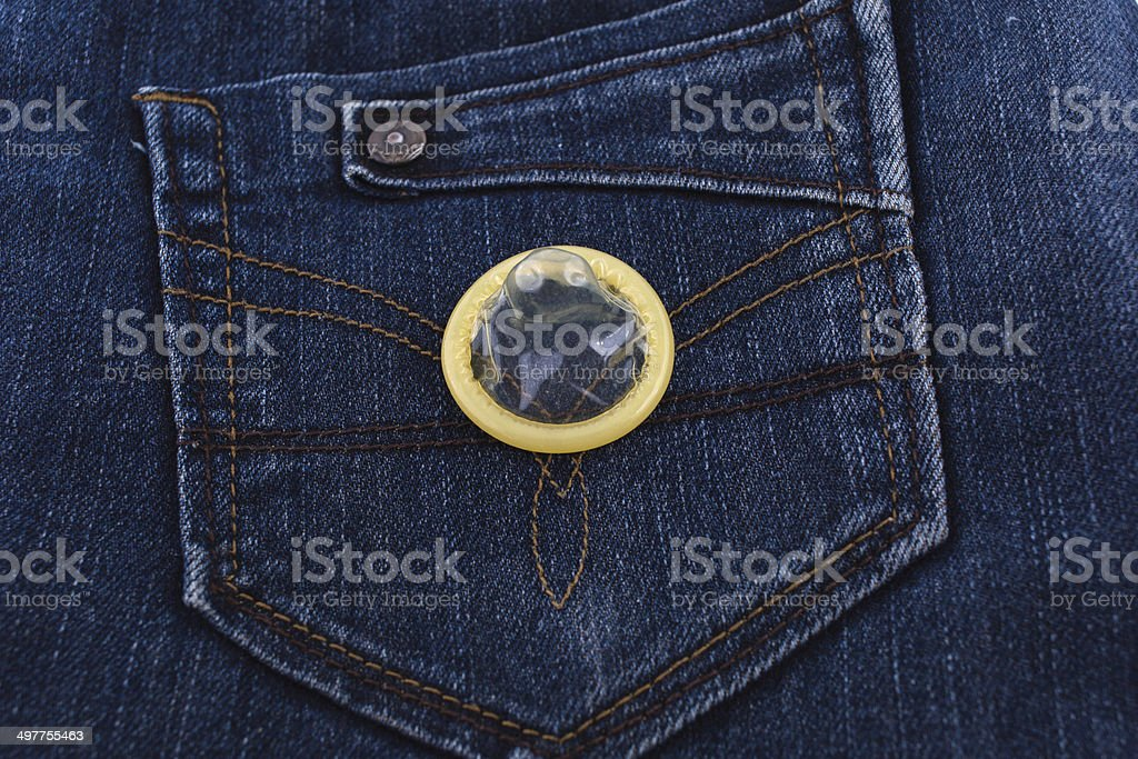 variety of Condoms in the blue jeans pocket royalty-free stock photo