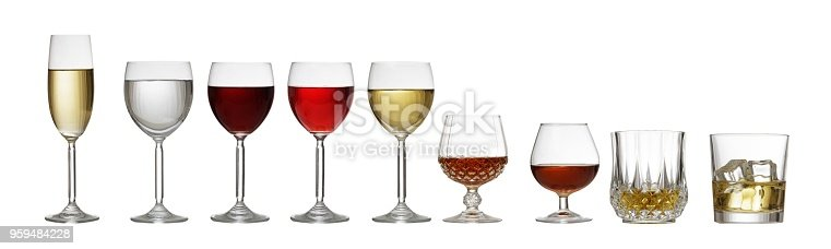Variety of crystal glasses on white background