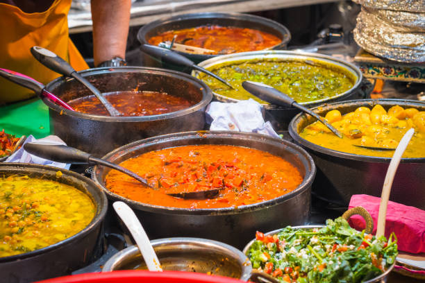 A variety of curries on display at Brick Lane Market in London stock photo