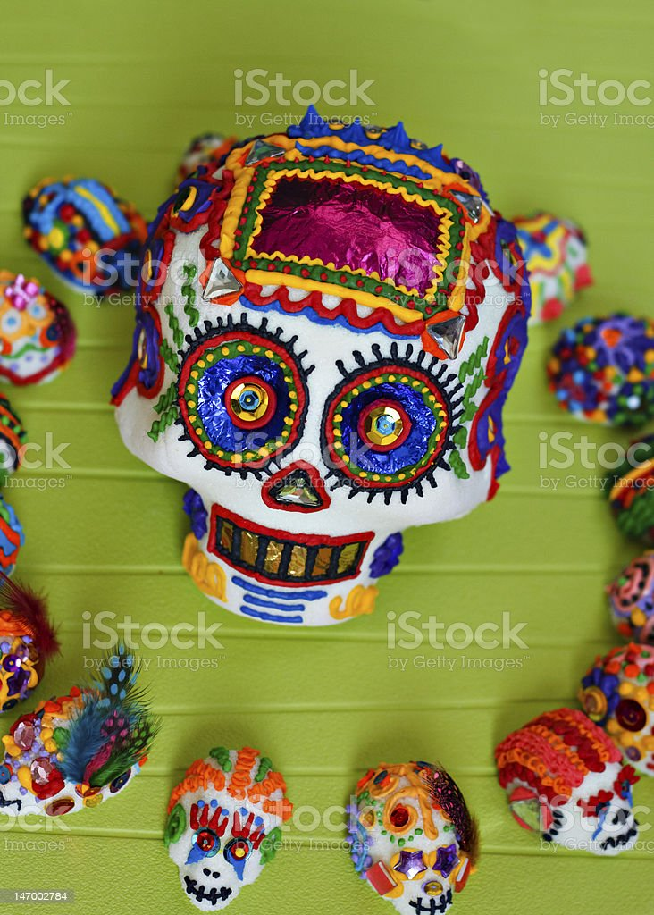 A variety of day of the dead sugar skulls in formation stock photo