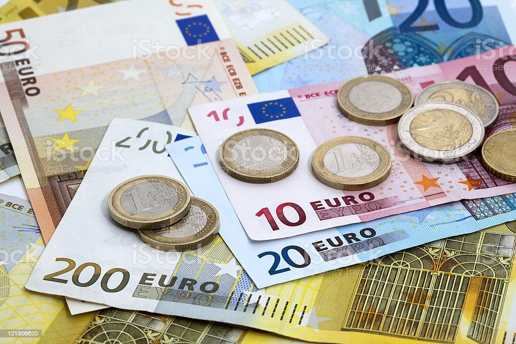 Variety of denominations of Euro coins and bills euro bills and coins Backgrounds Stock Photo