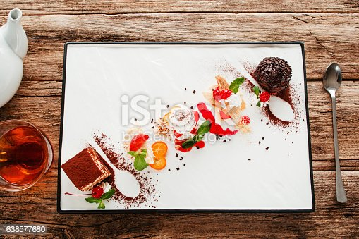 istock Variety of desserts with tea and spoon flat lay 638577680