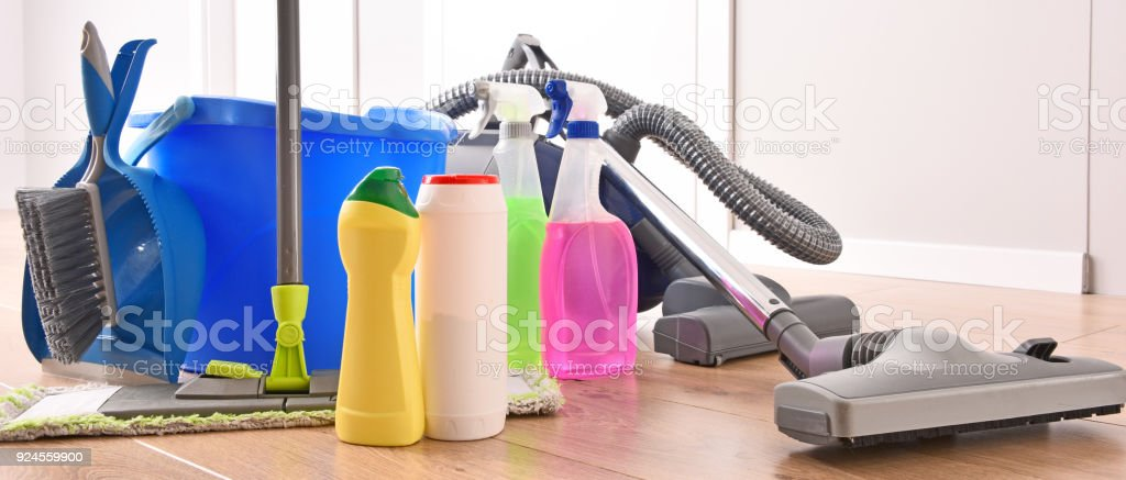 Vacuum cleaner and variety of detergent bottles and chemical cleaning...