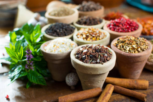 Variety of different asian and middle east spices, colorful assortment, on old wooden table stock photo