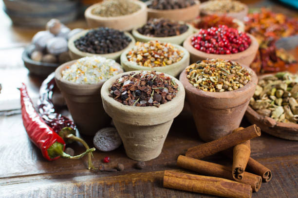 Variety of different asian and middle east spices, colorful assortment, on old wooden table Variety of different asian and middle east spices, colorful assortment, on old wooden table, close up garam masala stock pictures, royalty-free photos & images
