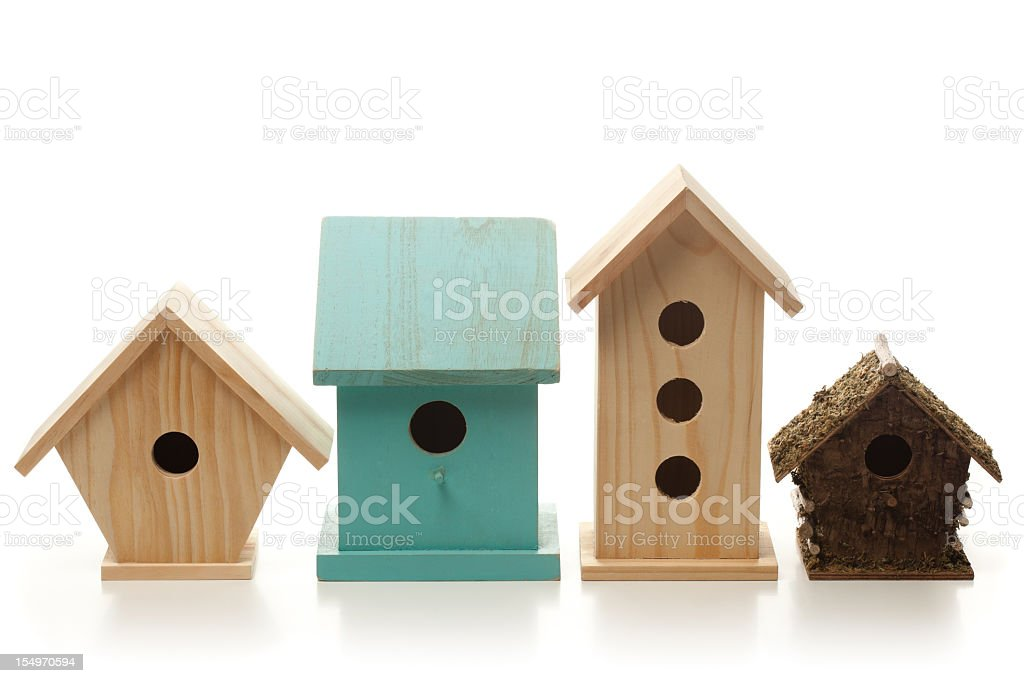 A variety of different wooden bird houses  stock photo