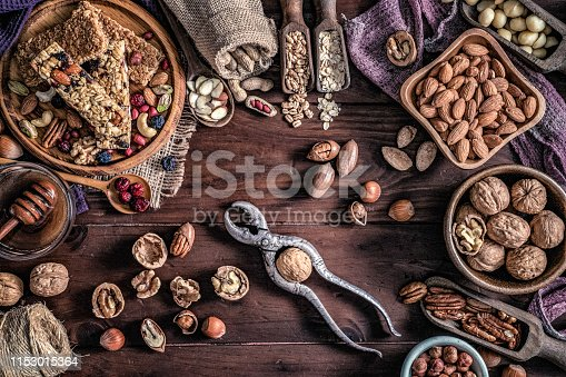 Variety of dried fruit and nuts on a table in a old fashioned rustic kitchen with nutcracker