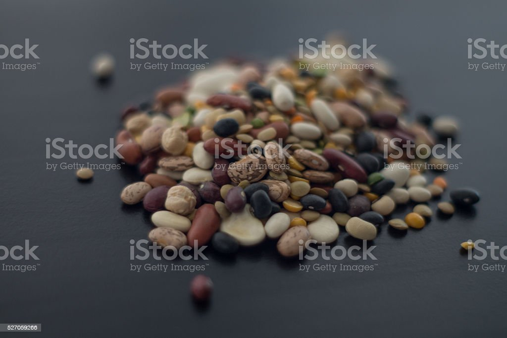 variety of dry beans in pile on black royalty-free stock photo