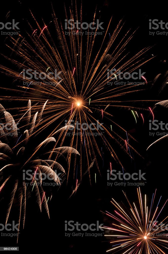 Variety of fireworks bursts in night sky royalty-free stock photo