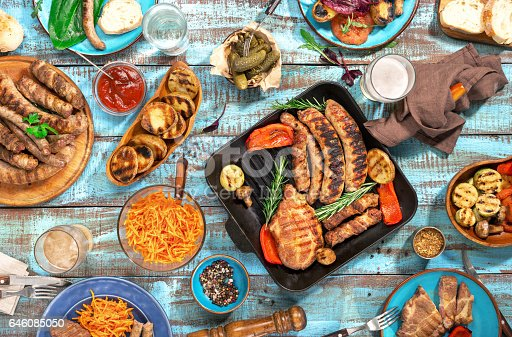 685404620istockphoto Variety of food grilled on wooden table, top view 646085050