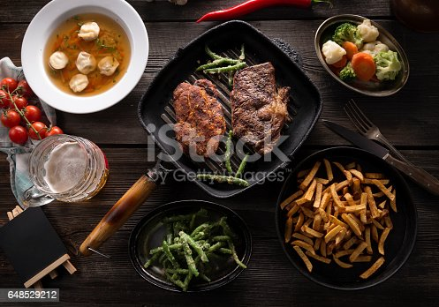685404620istockphoto Variety of food on wooden table 648529212