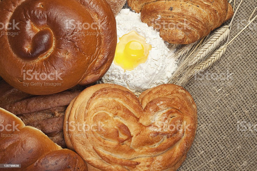 variety of fresh bread with rye ears and flour royalty-free stock photo
