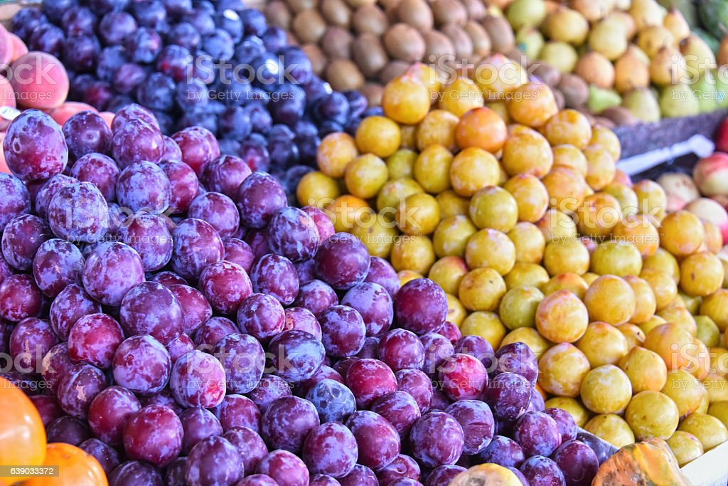 Variety of fresh ripe fruits on street market stall stock photo