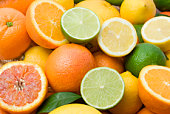istock Variety of full and halved citrus fruit 92134811