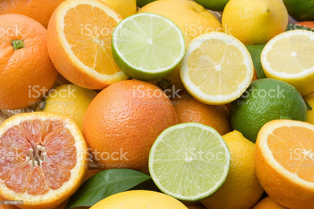 Variety of full and halved citrus fruit stock photo