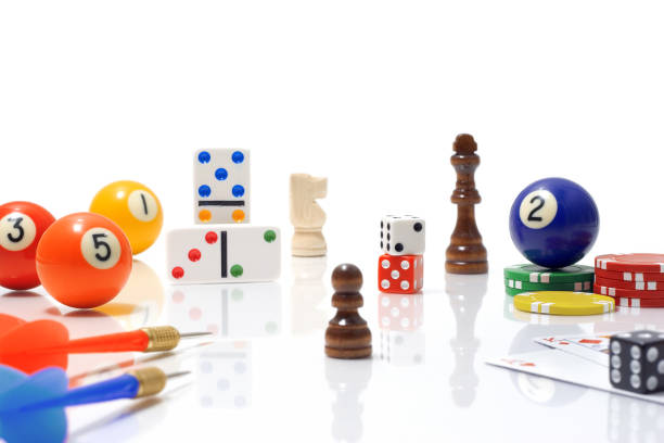 Variety of Game Pieces on White Background stock photo