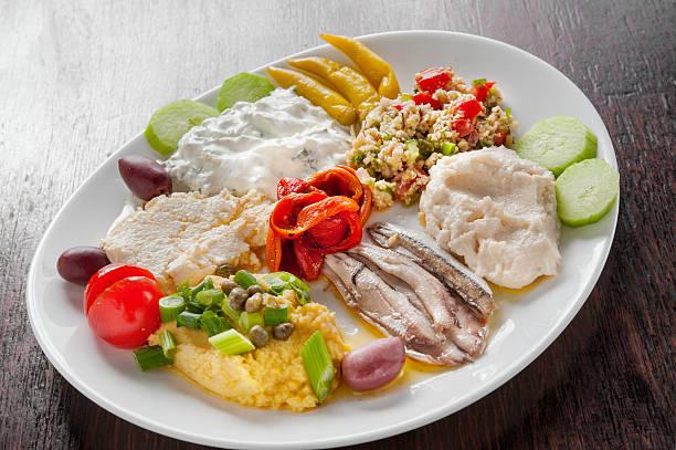 zahlreiche griechische appetithäppchen - taramosalata stock-fotos und bilder