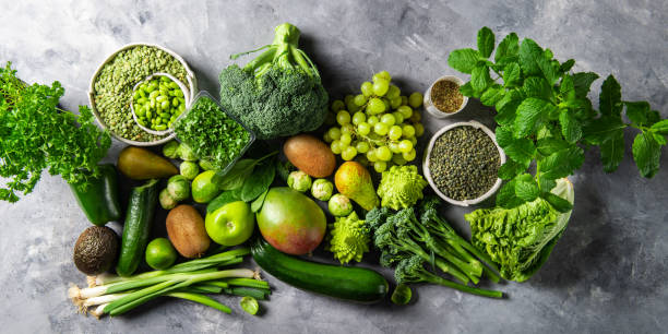 variety of green vegetables and fruits - vegano foto e immagini stock
