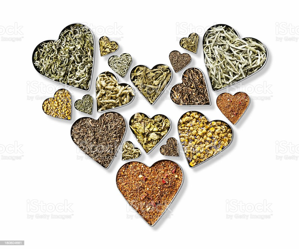 Variety of herbal tea leaves in heart shape bowls stock photo