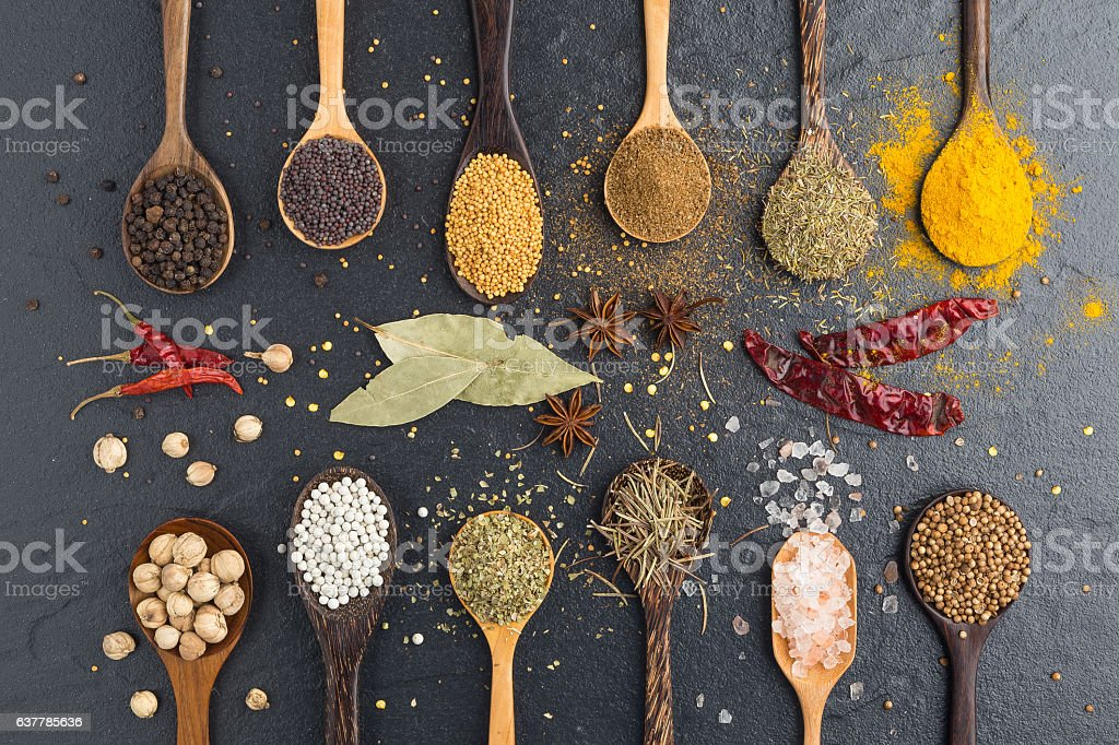 Variety of herbs and spicies ingredients. peppercorn, mustard, o stock photo