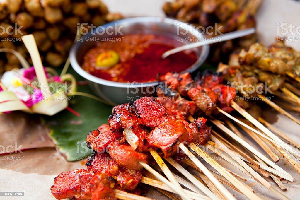 Variety of Indonesian cuisine next to salsa stock photo