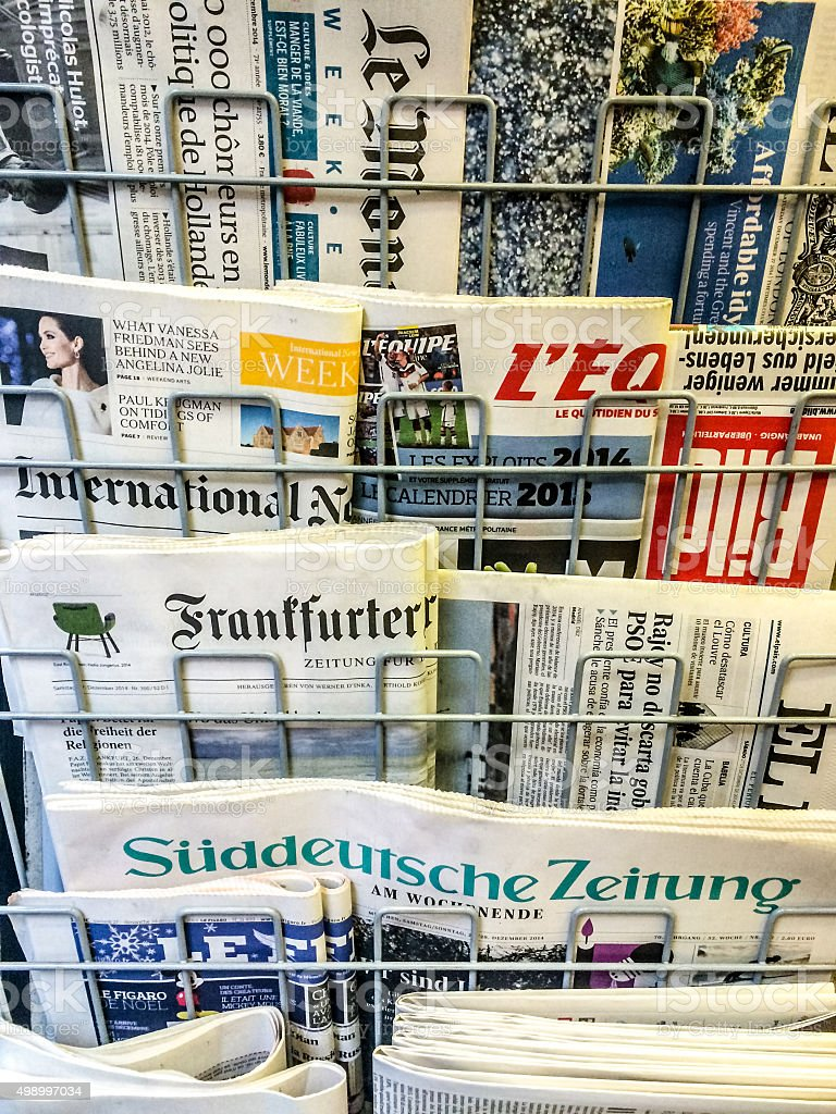 Variety of international newspapers sold on Milan street stock photo