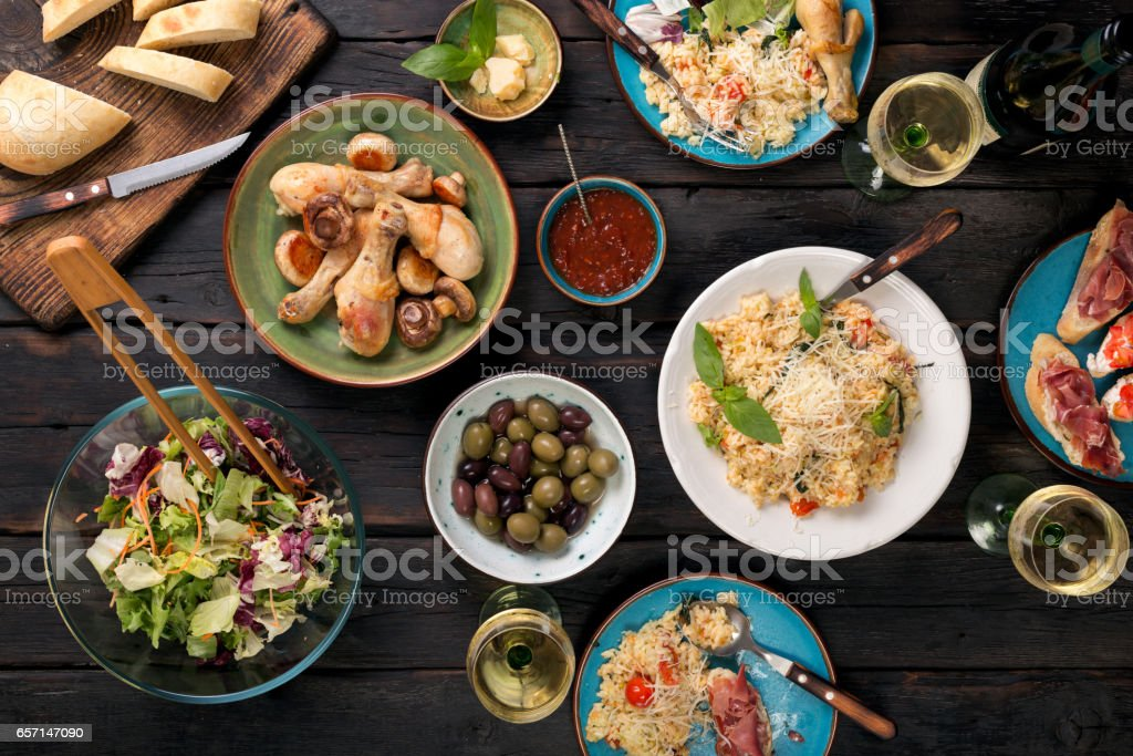 Variety of Italian food with wine on a dark wooden table stock photo