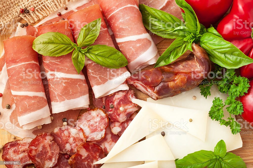 Variety of meat products and cheese stock photo