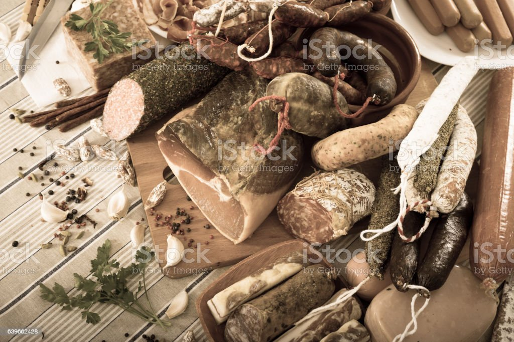 Variety of meats and sausages  on table stock photo