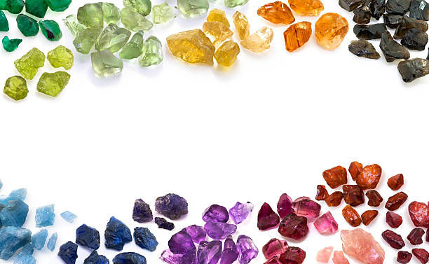 variety of natural colorful gems. horizontal composition. - edelsteen stockfoto's en -beelden