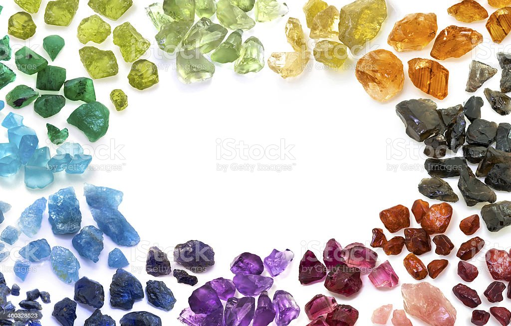 Variety of natural colorful gemstones on the white background. stock photo