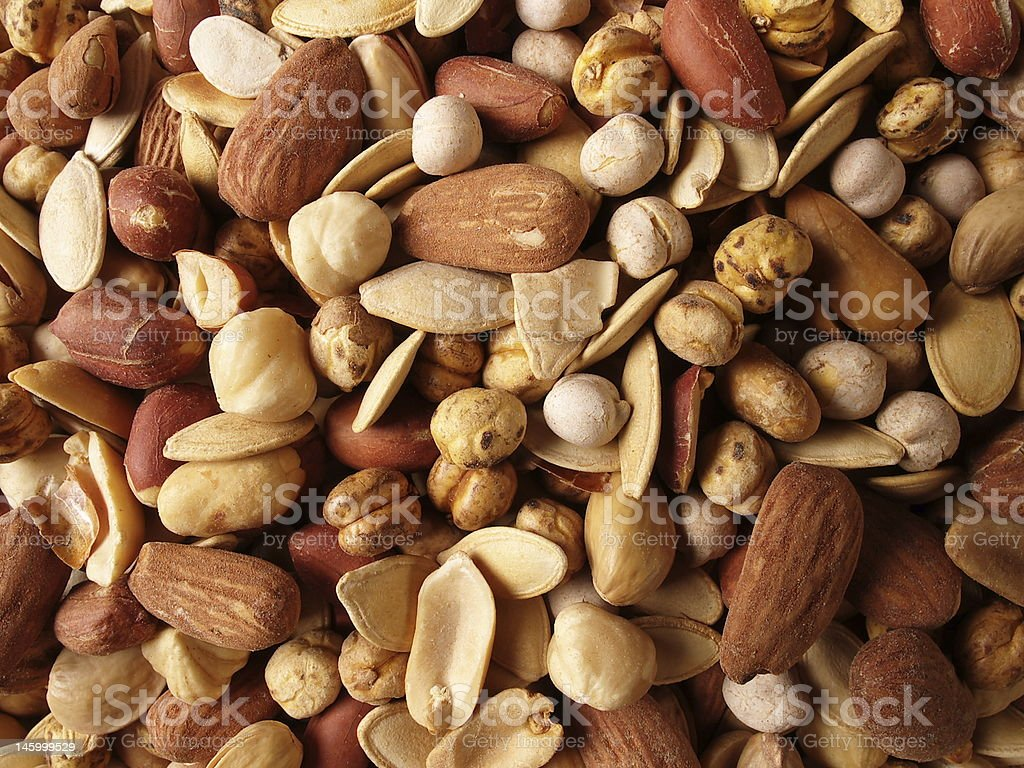 A variety of nuts and dried fruit stock photo